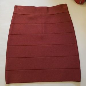 Bebe bandage skirt. Dark rust color. Size small